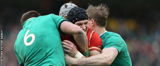 Wales' Tom James is tackled by CJ Stander and Andrew Trimble