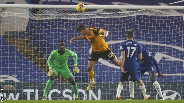 Wolves player Leander Dendoncker heads a chance wide during his side's Premier League game with Chelsea at Stamford Bridge