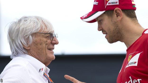 Bernie Ecclestone (left) and Sebastian Vettel