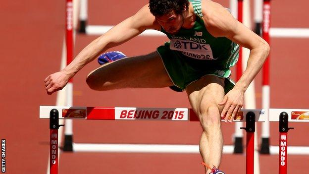 Ben Reynolds clears a hurdle in his World Championships heat