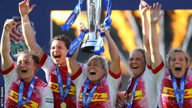 Harlequins captain Rachael Burford lifts the Premier 15s trophy