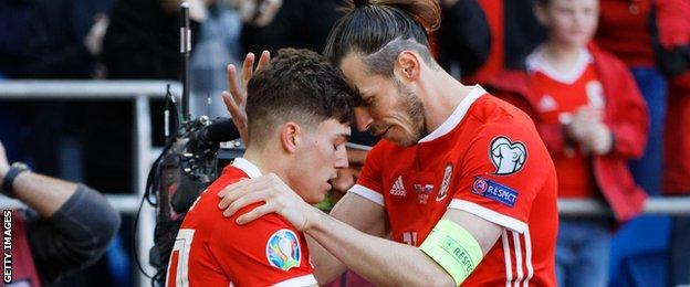 Bale and James hug