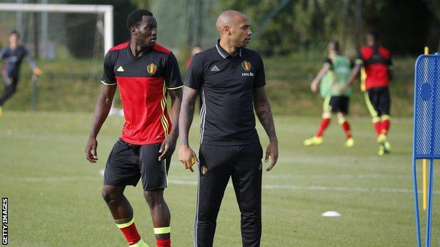Romelu Lukaku looks on as Thierry Henry coaches a Belgium training session