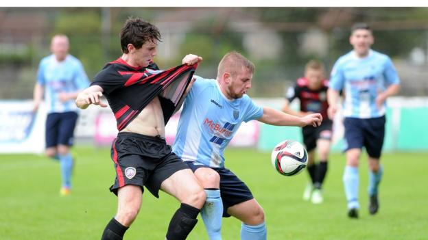 Coleraine captain Howard Beverland tangles with Ballymena winger David Cushley as the Bannsiders complete a 2-0 win