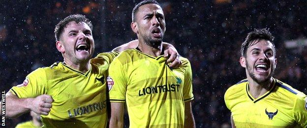 Oxford United celebrate victory at Notts County