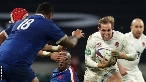 Max Malins runs with the ball against France