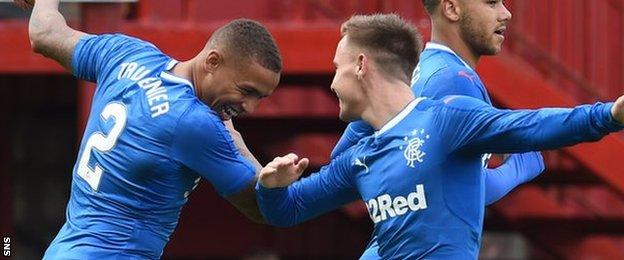 James Tavernier (left) celebrates scoring for Rangers in their opening League Cup match at Motherwell