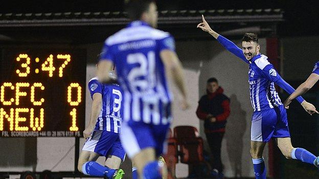 Darragh Noonan celebrates his early opener for Newry City at Solitude