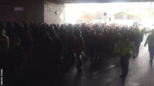Fans marching in protest before before Saturday's match