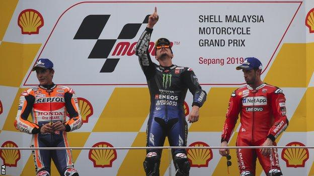 Maverick Vinales (centre) on the podium with Marc Marquez (left) and Andrea Dovizioso after the Malaysian Grand Prix