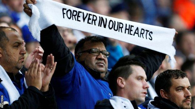 Fans were given scarves as they paid their respects