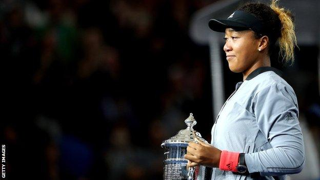 Naomi Osaka with the US Open trophy