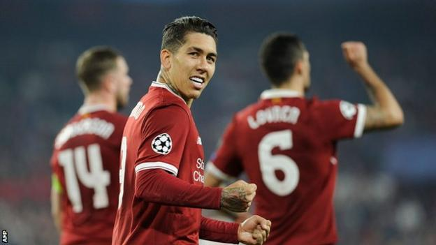 Liverpool forward Roberto Firmino celebrates scoring against Sevilla