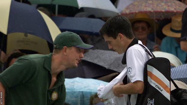 Tim Henman leaves Centre Court mid-semi-final