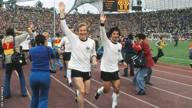 Hans-Georg Schwarzenbeck and Gerd Muller (right) celebrate winning the World Cup