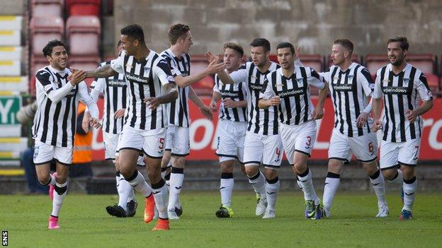 Dunfermline Athletic players celebrate taking the lead against Dundee