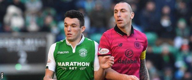 Hibernian midfielder John McGinn (left) And Celtic's Scott Brown