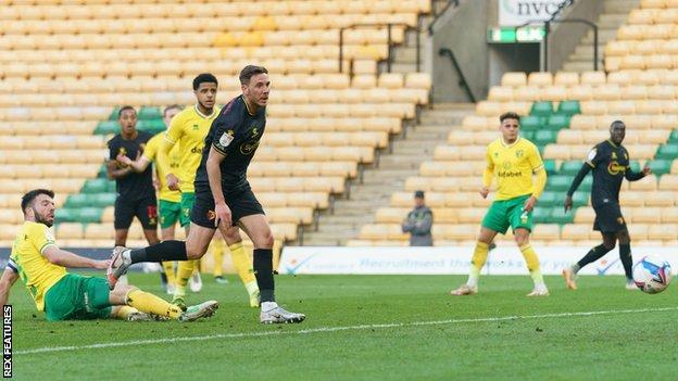 Dan Gosling scores against Norwich
