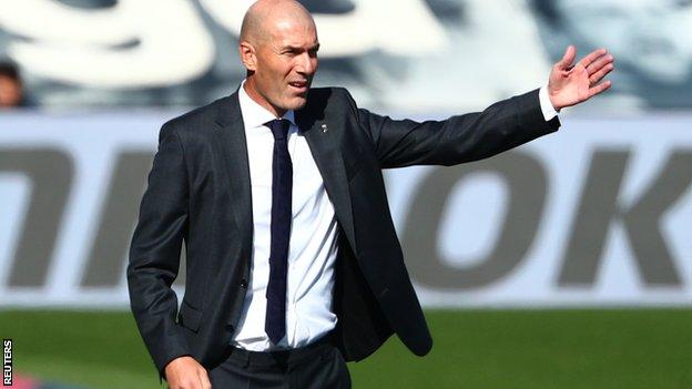Real Madrid boss Zinedine Zidane reacts during a match