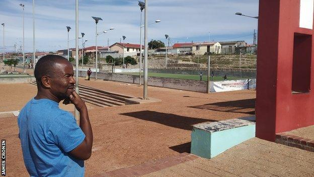 Dumi looks out at the football pitch