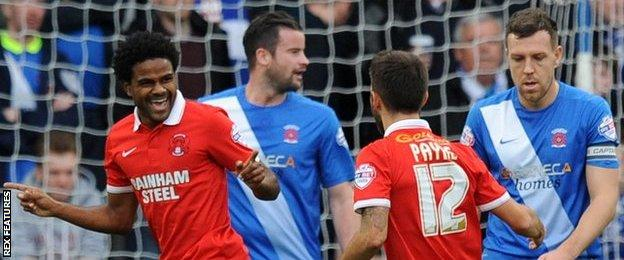 Leyton Orient's Bradley Pritchard celebrates his first-half goal against Hartlepool
