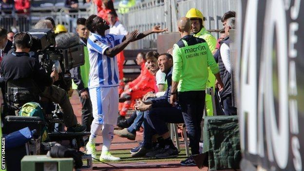 Sulley Muntari reacts with supporters during Pescara's 1-0 defeat at Cagliari