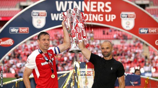 Rotherham's match-winner Richard Wood (left) lifts the play-off winners trophy with boss Paul Warne (right)