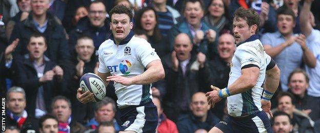 Duncan Taylor races down the right wing to score for Scotland