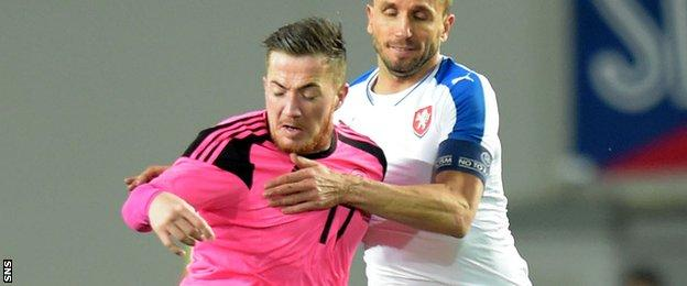Ross McCormack holds the ball up for Scotland