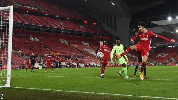 Curtis Jones scores for Liverpool against Ajax in the Champions League at Anfield