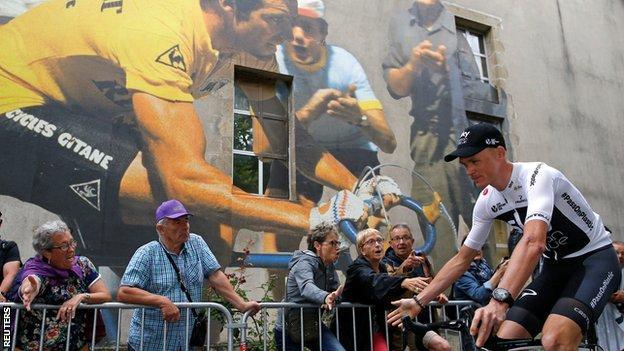 Chris Froome rides past spectators at the presentation event in La Roche-sur-Yon