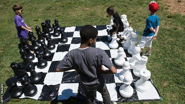 Children playing outside chess