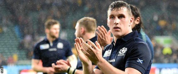 Mark Bennett applauds Scotland fans moments after their 35-34 defeat against Australia in the World Cup quarter final.