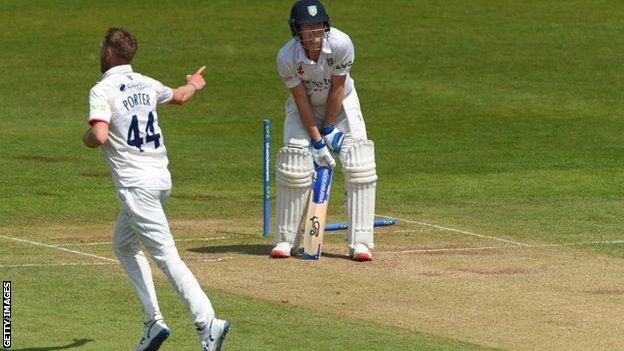 Jamie Porter celebrates taking the wicket of Cameron Bancroft