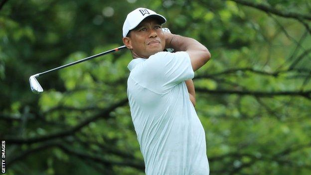 Tiger Woods holds his backswing after playing a shot