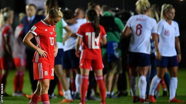 Jessica Fishlock of Wales looks dejected as England celebrate