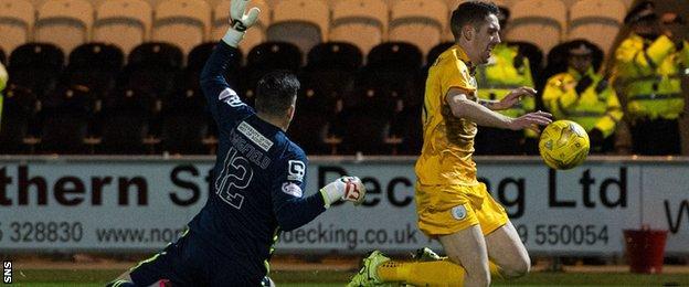Stefan McCluskey goes down under Jamie Langfield's challenge