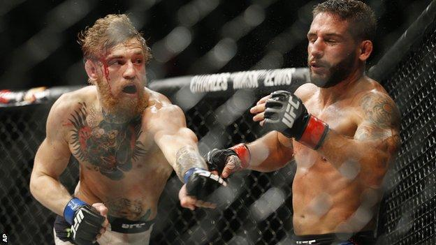 Conor McGregor (left) in action against Chad Mendes