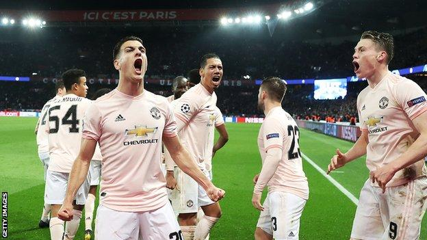 Manchester United players celebrate after their win over Paris St-Germain