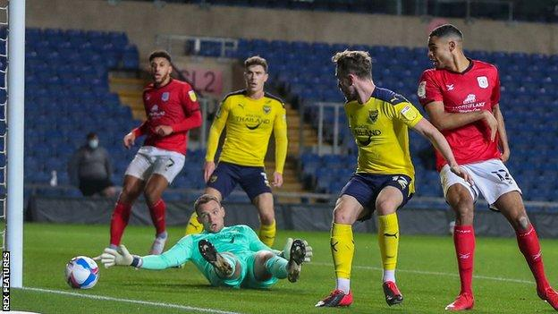 Mikael Mandron opens the scoring for Crewe at Oxford