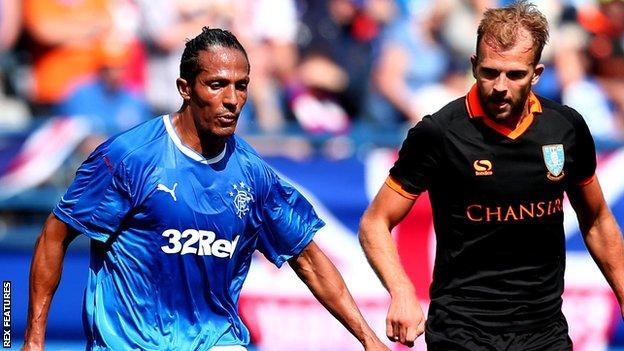 Rangers defender Bruno Alves and Sheffield Wednesday's Jordan Rhodes