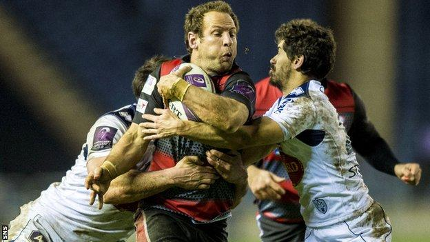 Edinburgh's Andries Strauss (centre) is tackled by Clement Darbo (left) and Alban Donduche