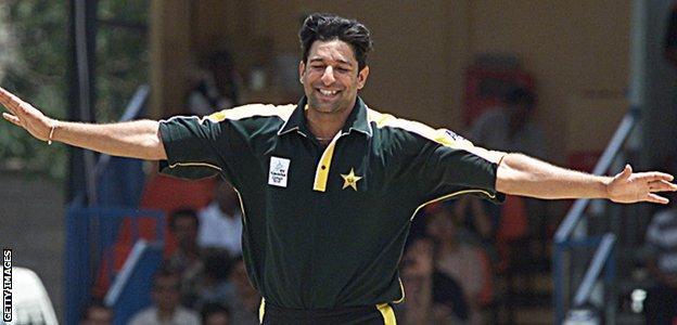 Wasim Akram celebrates taking a wicket