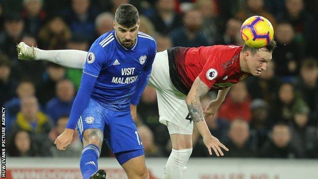 Cardiff City's Callum Paterson battles for the ball with Phil Jones of Manchester United