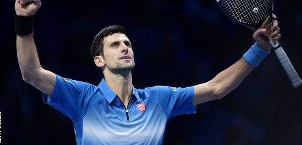 Serbia's Novak Djokovic celebrates after beating Spain's Rafael Nadal in the men's singles semi-final match