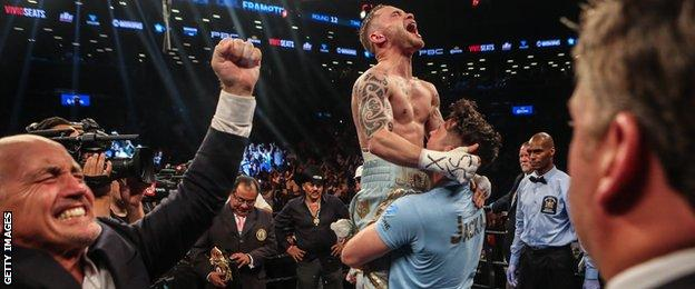 Barry McGuigan (left) celebrates as Frampton is hoisted into the air by trainer Shane McGuigan after his victory over Leo Santa Cruz in New York a year ago