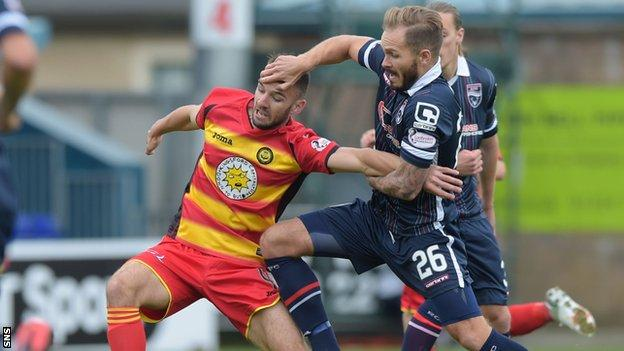 Martin Woods (right) closes down Partick's Sean Welsh during the Scottish Premiership clash