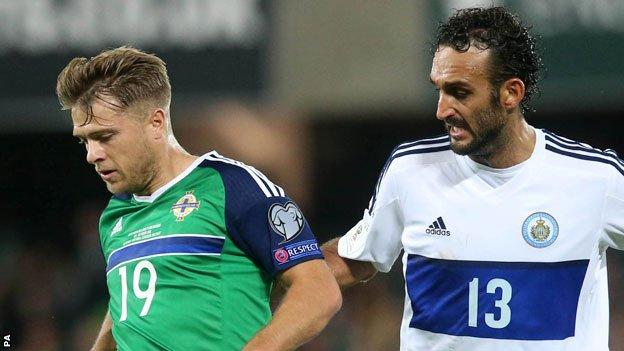 Jamie Ward of Northern Ireland and San Marino's Alessandro Della Valle battle for the ball at Windsor Park