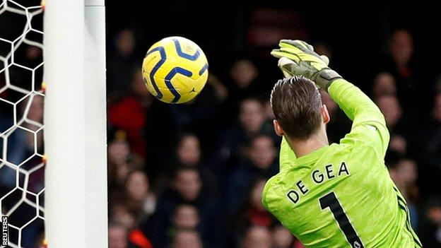 David de Gea allows Ismaila Sarr's shot to slip through his grasp