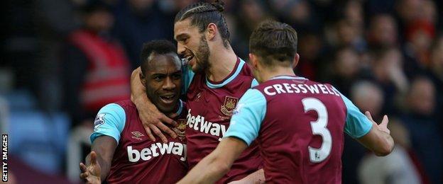 Michail Antonio (left) celebrates scoring for West Ham United.